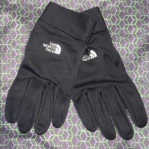 unisex L north face gloves.